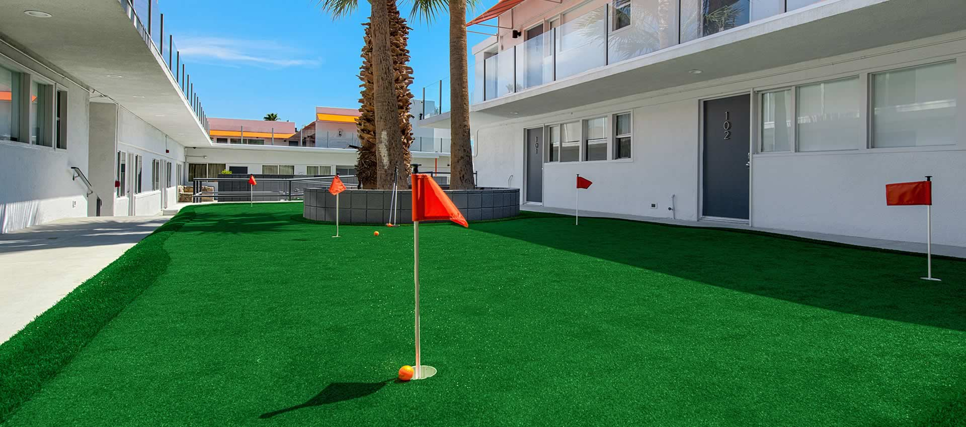 The putting green among the rooms