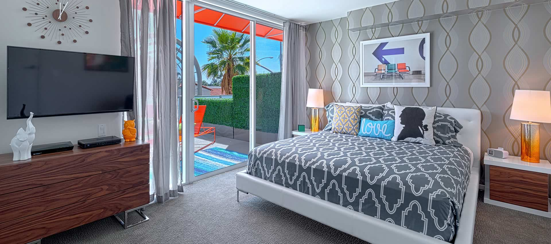 another view of the bedroom with view of patio out the sliding glass doors