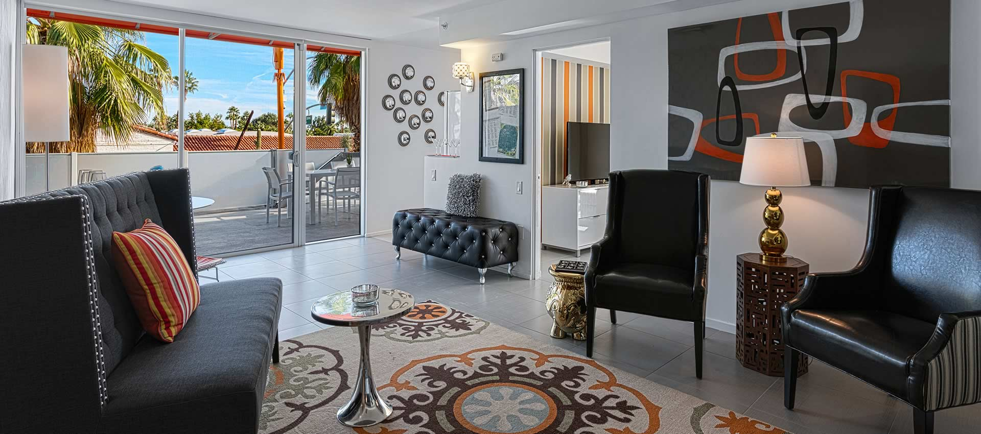 twist hotel room 219 living room with tables and chairs with a view out the big windows of the patio