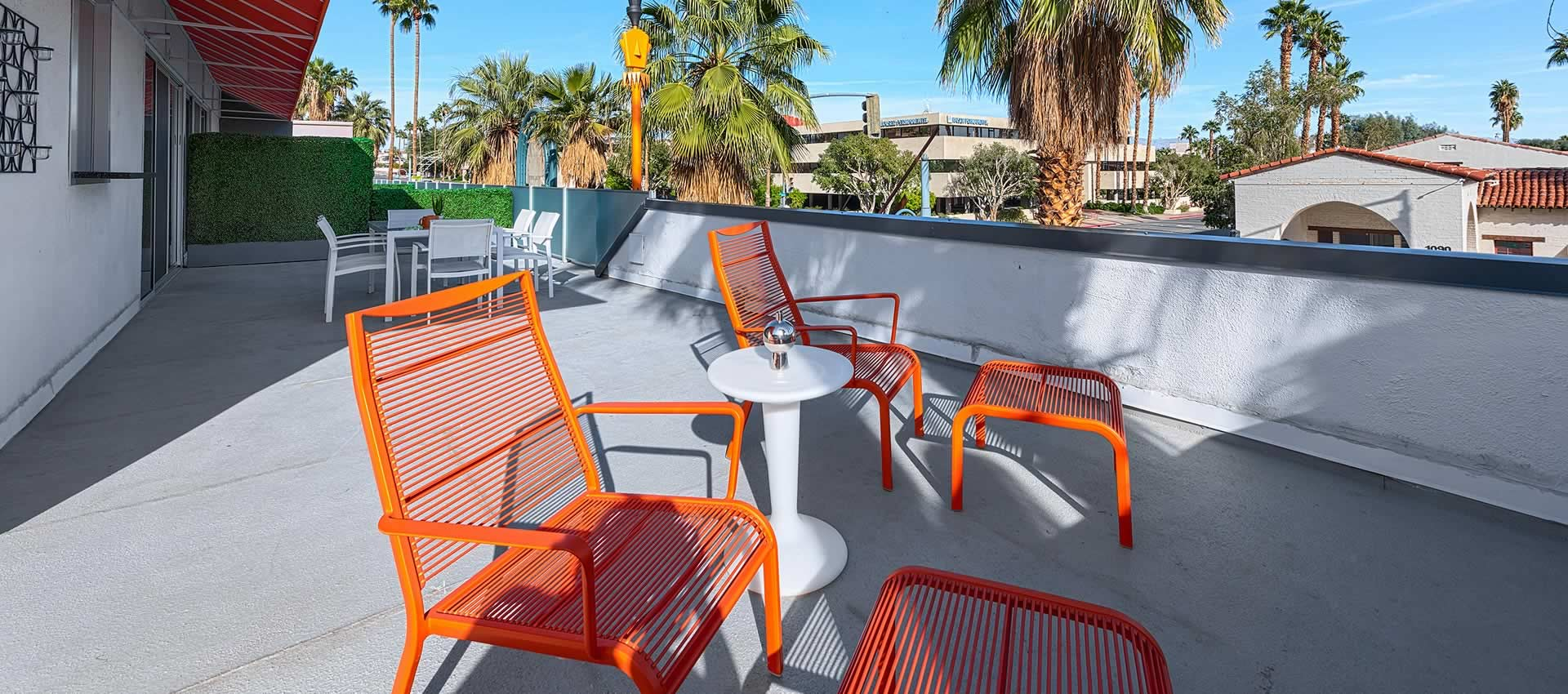 twist hotel room 219 balcony with tables and chairs