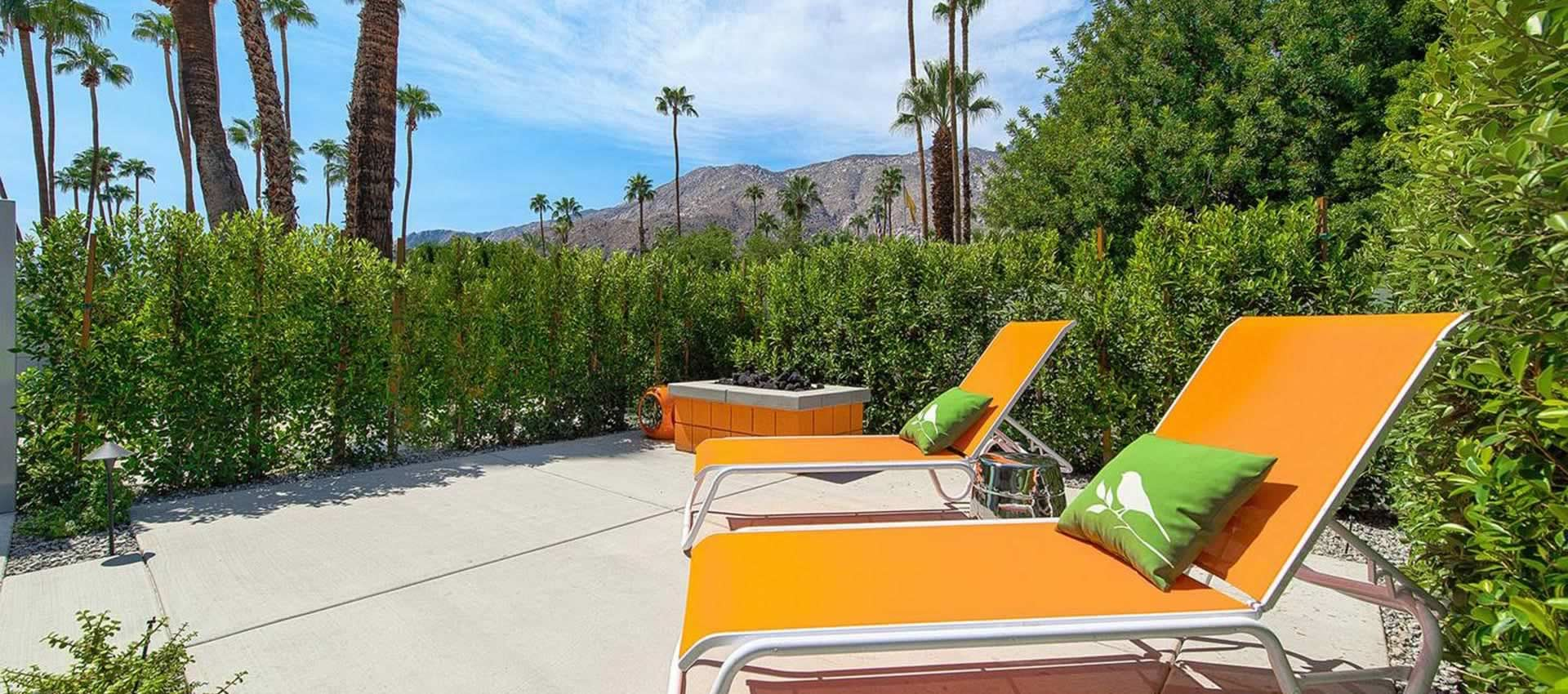 Twist Hotel Unit 107 patio, orange chairs and firepit