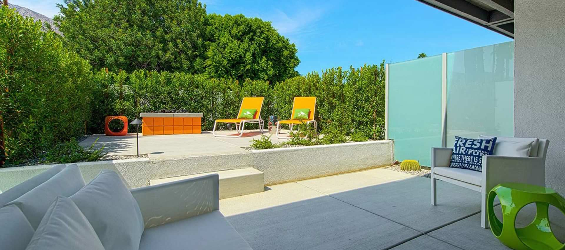 Twist Hotel Unit 107 patio sitting area with firepit
