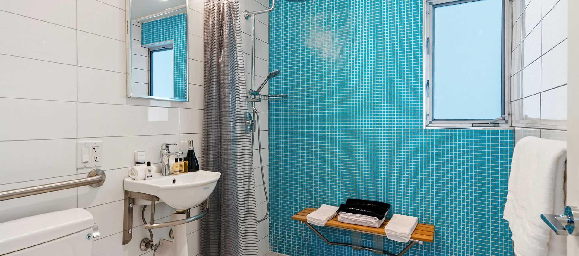 Studio 103 bright modern bathroom witl teal tile shower