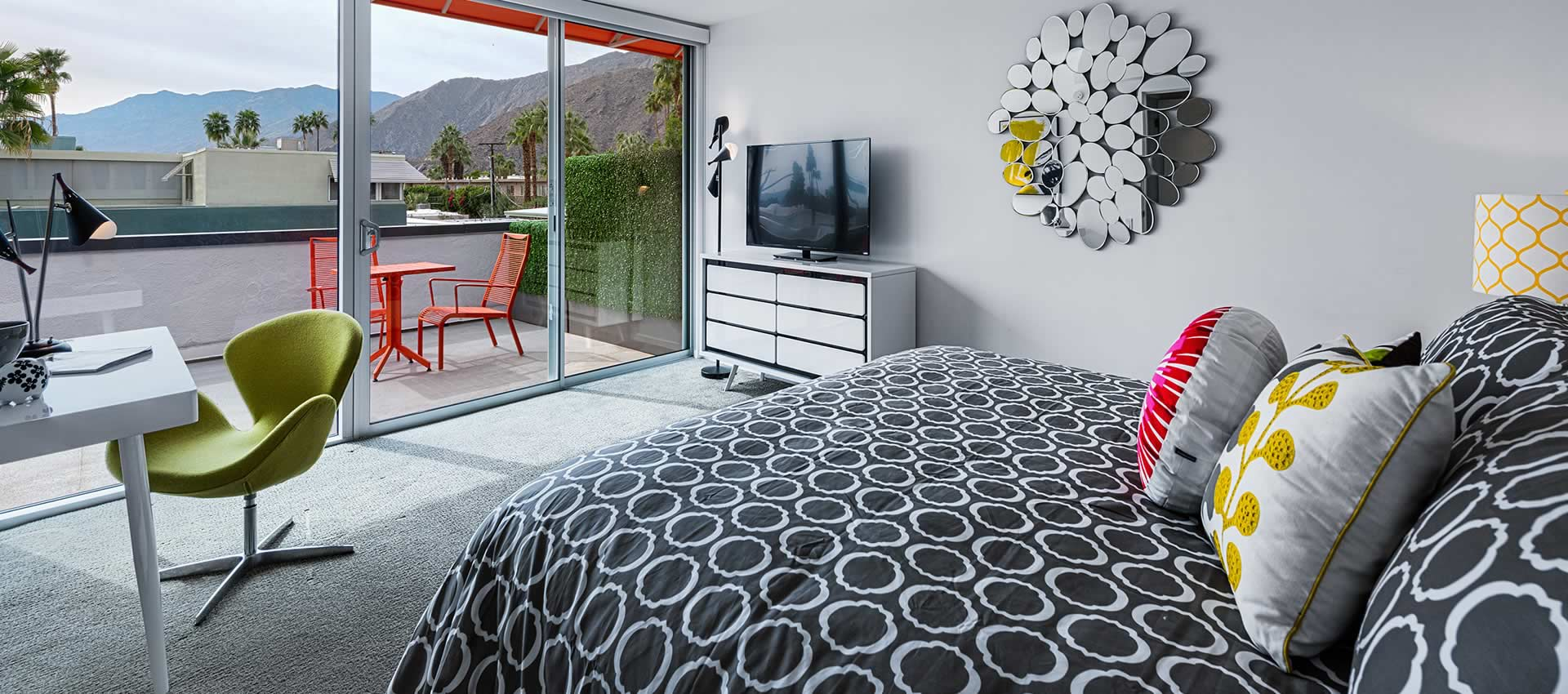 twist hotel room 221 bedroom with bed, TV and view of the mountains out the big windows