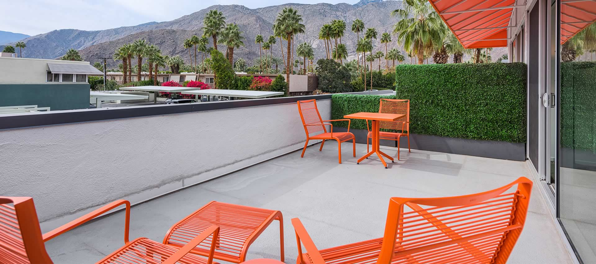 the patio of twist hotel room 221  with view on the mountains
