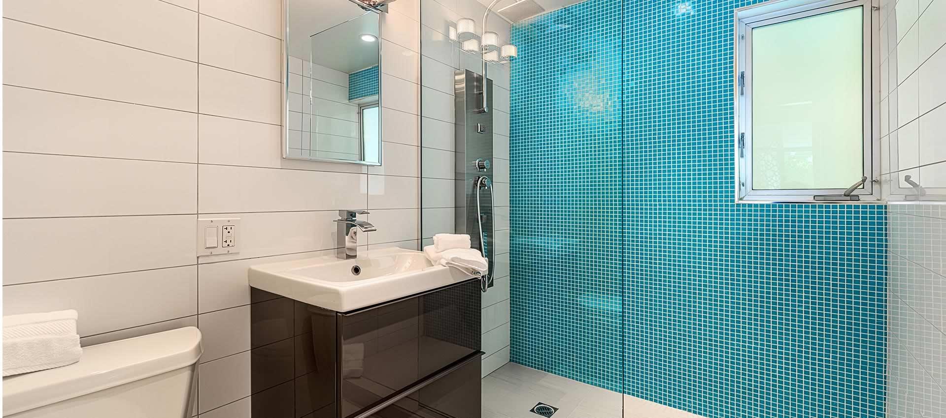 twist hotel studio room bright modern bathroom teal shower