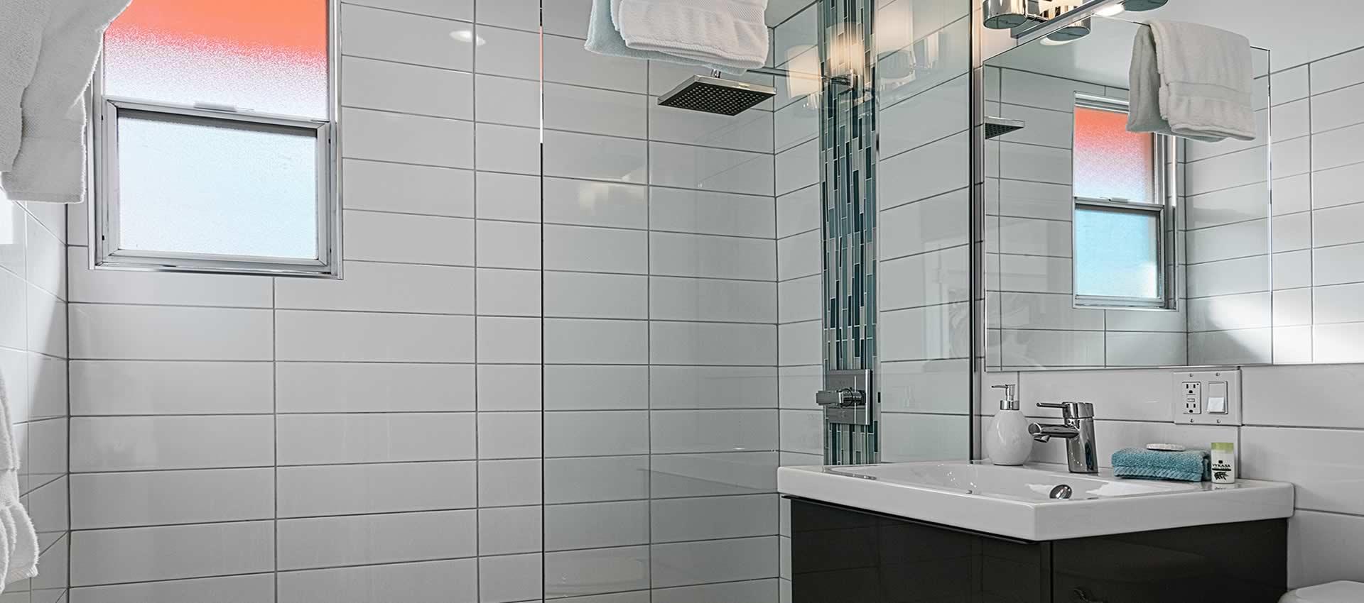 twist hotel bathroom shower white tile